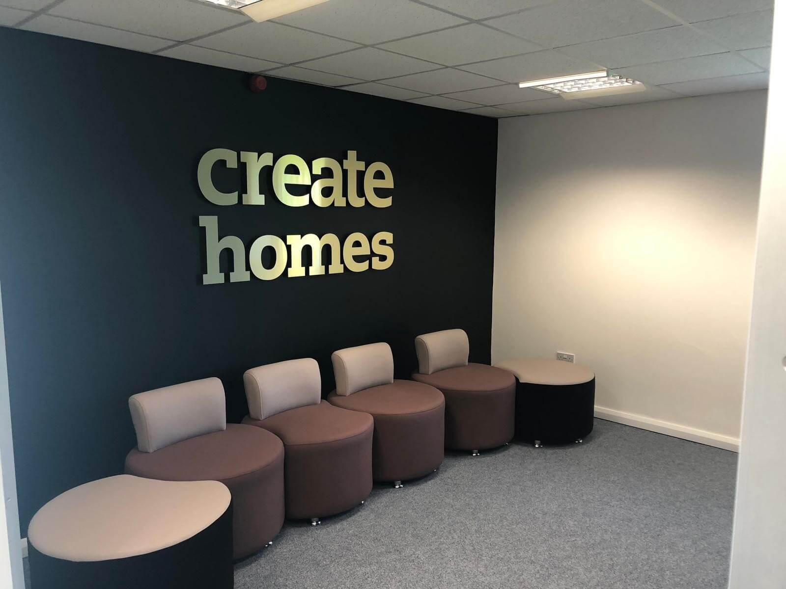 Create Homes UK internal signage brushed gold logo